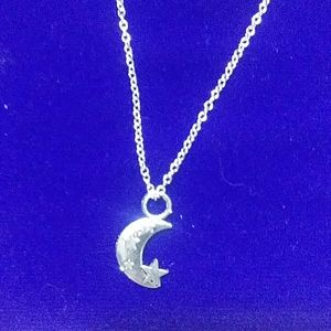Silver necklace 18in with moon and stars charm